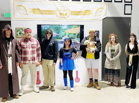Live Green Landscape employees dressed up in Halloween costumes